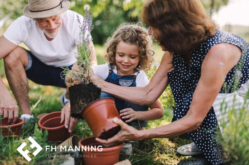 Little girl gardening with her granparents